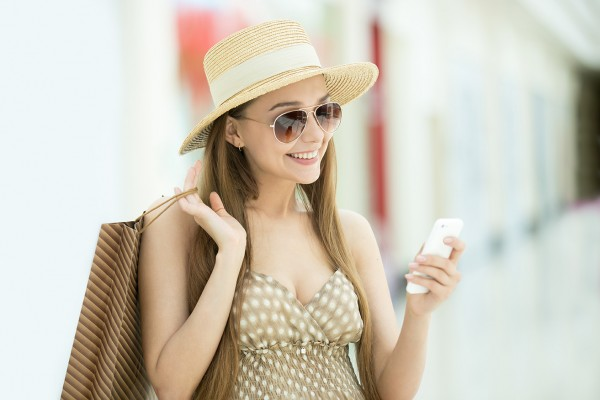 Woman in shopping centre looking at mobile phone
